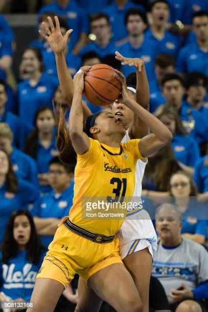 Bruins forward Monique Billings defends as California Golden Bears forward/center Kristine Anigwe goes to the basket during the game between the Cal...