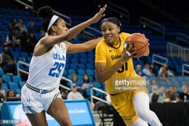 Bruins forward Monique Billings defends California Golden Bears forward/center Kristine Anigwe as she drives the ball to the basket during the game...