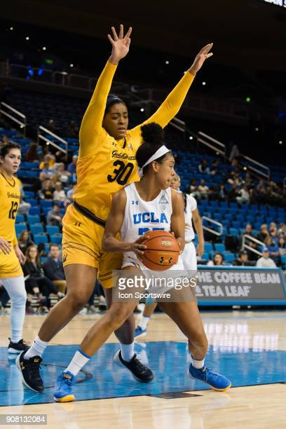 Bruins forward Monique Billings is defended by California Golden Bears center CJ West during the game between the Cal Berkeley Golden Bears and the...