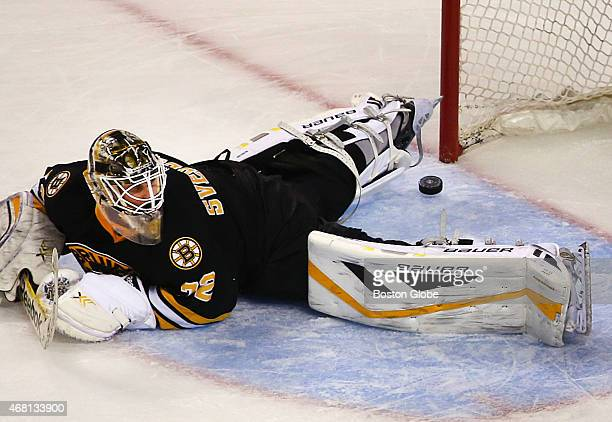 Bruins goalie Niklas Svedberg lays flat in the crease as the Rangers' Rick Nash's shot lies between his legs after a second period goal
