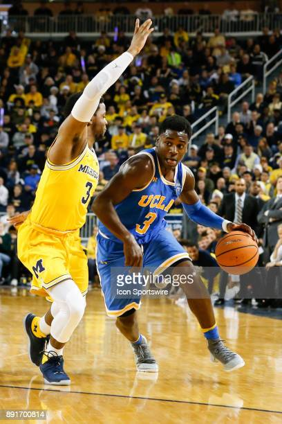 Bruins guard Aaron Holiday drives to the basket against Michigan Wolverines guard Zavier Simpson during a regular season nonconference basketball...