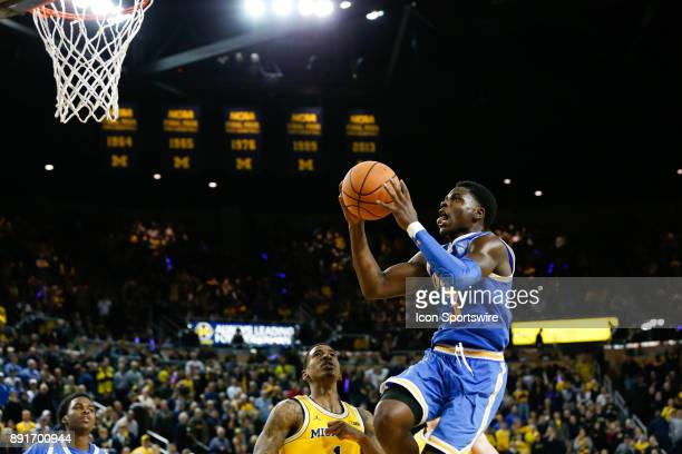 Bruins guard Aaron Holiday goes in for a layup during a regular season nonconference basketball game between the UCLA Bruins and the Michigan...