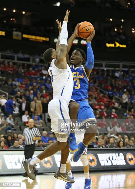 Bruins guard Aaron Holiday tries to shoot over Creighton Bluejays guard Marcus Foster in the first half of the semifinal game of the CBE Hall of Fame...