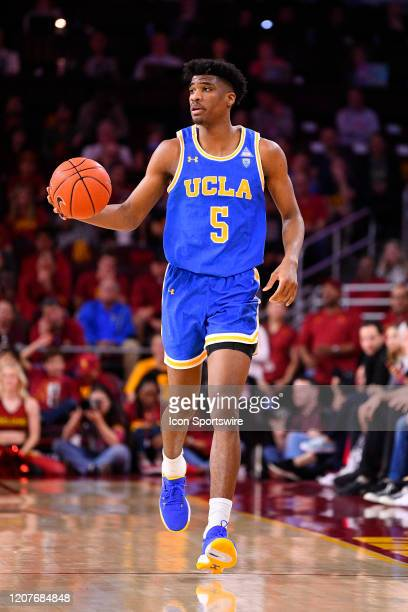 Bruins guard Chris Smith brings the ball up the court during the college basketball game between the UCLA Bruins and the USC Trojans on March 7 2020...