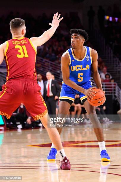Bruins guard Chris Smith defended by USC Trojans forward Nick Rakocevic during the college basketball game between the UCLA Bruins and the USC...