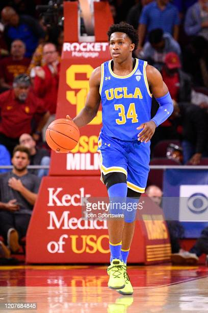 Bruins guard David Singleton brings the ball up the court during the college basketball game between the UCLA Bruins and the USC Trojans on March 7...