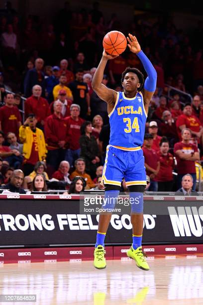 Bruins guard David Singleton shoots a three pointer during the college basketball game between the UCLA Bruins and the USC Trojans on March 7 2020 at...