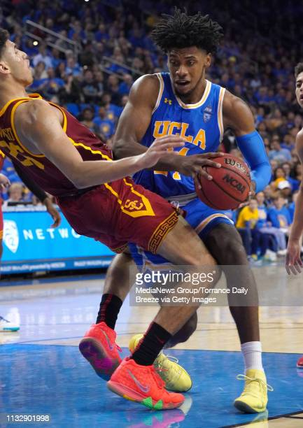 Bruins guard Jalen Hill commits a charging foul on USC Trojans forward Bennie Boatwright at Pauley Pavilion in Los Angeles on Thursday Feb 28 2019...