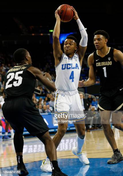 Bruins guard Jaylen Hands attempts a shot over Colorado Buffaloes guard McKinley Wright during the game on February 06 at Pauley Pavilion in Los...
