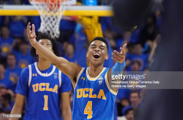Bruins guard Jaylen Hands gestures to head coach Murry Bartow in the final seconds of overtime at Pauley Pavilion in Los Angeles on Thursday Feb 28...