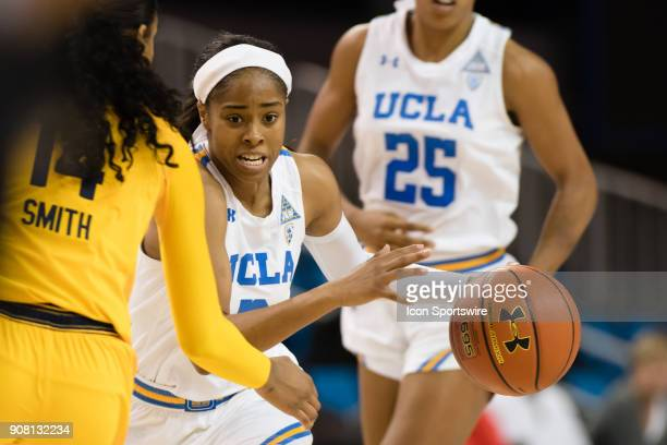 Bruins guard Jordin Canada drives the ball around California Golden Bears guard Kianna Smith during the game between the Cal Berkeley Golden Bears...