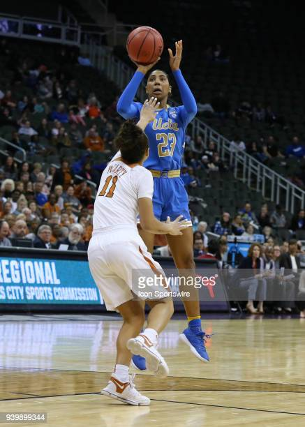 Bruins guard Kelli Hayes shoots a jumper over Texas Longhorns guard Brooke McCarty in the fourth quarter of a third round NCAA Division l Women's...