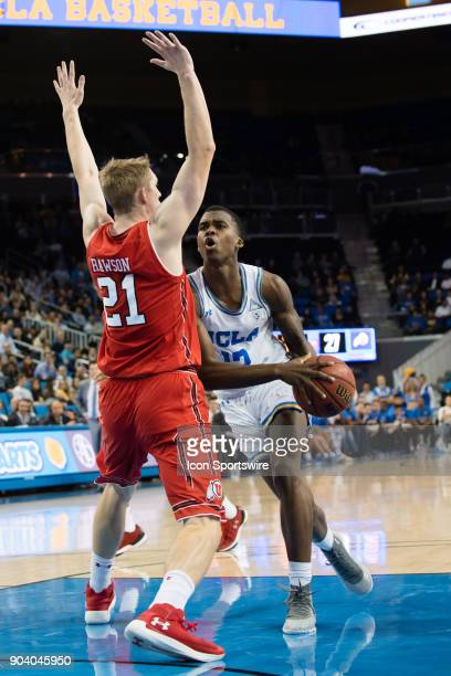 Bruins guard Kris Wilkes drives into the basket against Utah Utes forward Tyler Rawson during the game between the Utah Utes and the UCLA Bruines on...