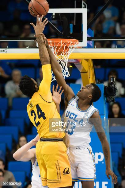 Bruins guard Kris Wilkes gets a hold of the arm of California Golden Bears forward Marcus Lee as he shoots a basket during the game between the...