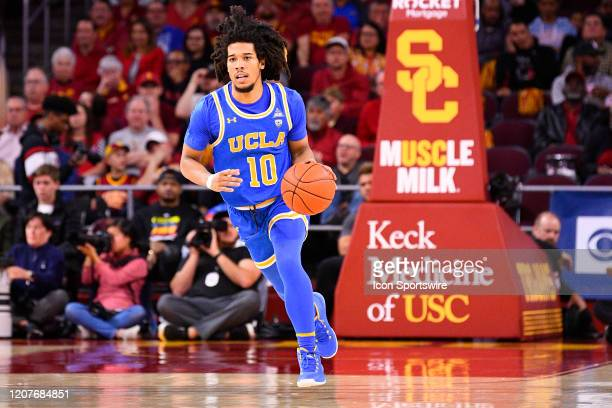 Bruins guard Tyger Campbell brings the ball up the court during the college basketball game between the UCLA Bruins and the USC Trojans on March 7...