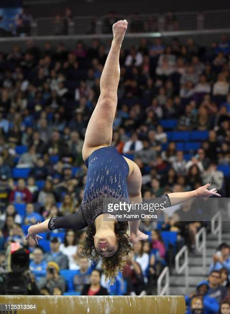 Bruins gymnast Katelyn Ohashi performs her balance beam routing in the meet against the Arizona Wildcats at Pauley Pavilion on February 16, 2019 in...