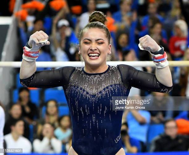 Bruins gymnast Norah Flatley reacts after landing her bar routine in the meet against the Arizona Wildcats at Pauley Pavilion on February 16 2019 in...