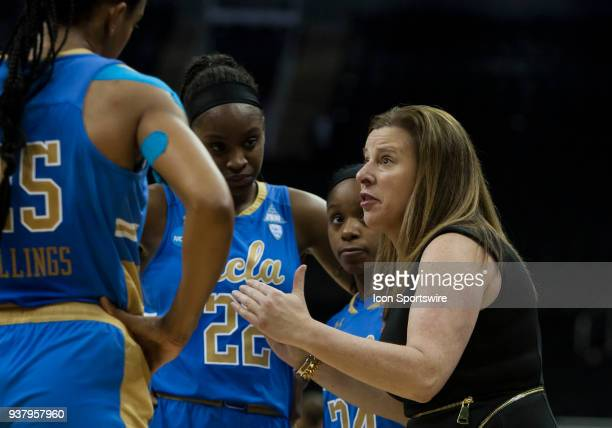 Bruins head coach Cori Close attempts to provide last minute instructions to her team during the NCAA Division I Women's quarter final game between...
