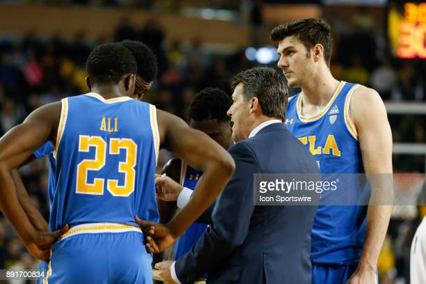 Bruins head coach Steve Alford talks to his team during a timeout during a regular season nonconference basketball game between the UCLA Bruins and...