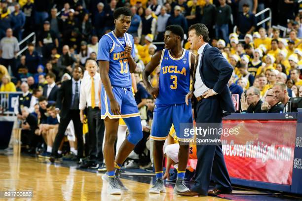 Bruins head coach Steve Alford talks to UCLA Bruins guard Aaron Holiday and UCLA Bruins guard Kris Wilkes during a regular season nonconference...