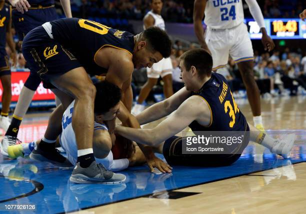 Bruins Jules Bernard fights for the ball against California Golden Bears Matt Bradley and Grant Anticevich during the game on January 05 at Pauley...