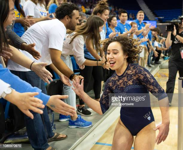 Bruins' Katelyn Ohashi celebrates with the student section during an NCAA college gymnastics meet against Arizona State in Los Angeles Monday Jan 21...