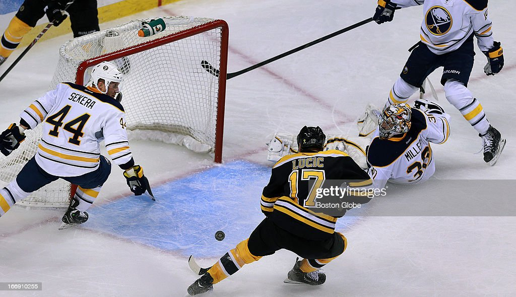 Bruins left winger Milan Lucic (#17) had an open net in the second period, but couldn't score, as Sabres goalie Ryan Miller (#30) was down and out. It appeared that Buffalo defenseman Andrej Sekera (#44) made the stop with his stick. The Boston Bruins hosted the Buffalo Sabres in a regular season NHL game at TD Garden.