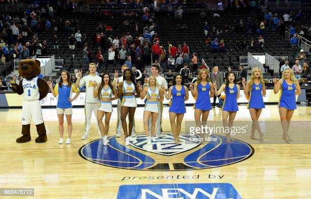 Bruins mascot Joe Bruin and UCLA cheerleaders stand on the court after the team's 7674 win over the USC Trojans in a quarterfinal game of the Pac12...