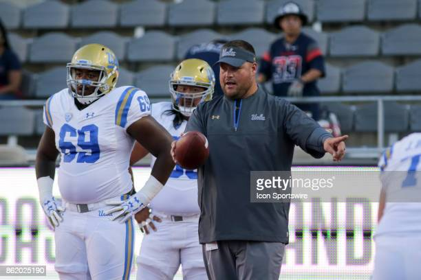 Bruins offensive line coach Hank Fraley runs drills before a college football game between the UCLA Bruins and Arizona Wildcats on October 14 at...