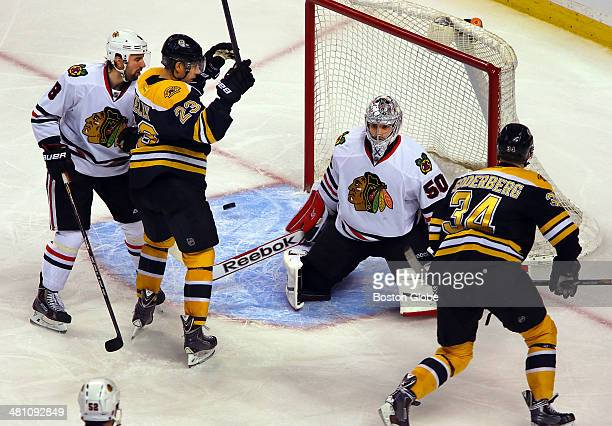 Bruins player Carl Soderberg right scored a third period goal past Chicago goalie Corey Crawford as Chris Kelly left celebrates next to Chicago's...