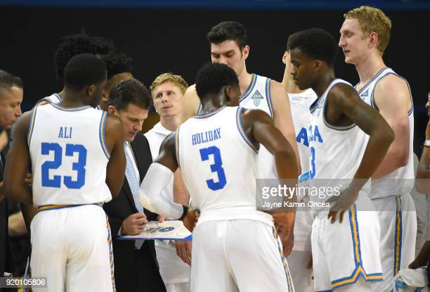 Bruins players gather around head coach Steve Alford during a time out in the game against the Oregon State Beavers at Pauley Pavilion on February 15...