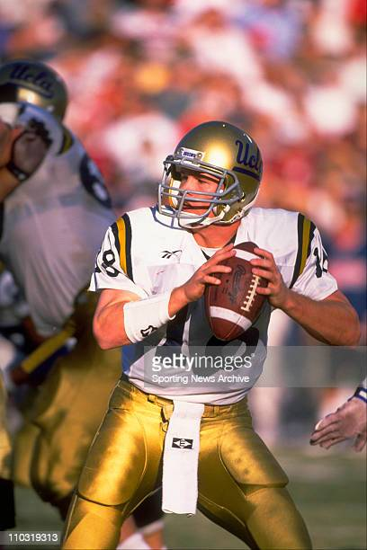 Bruins quarterback Cade McNown passing the ball during a PAC10 game against the Arizona Wildcats on November 16 1996 in Tuscon Arizona won the game...