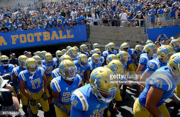 Bruins run on to the field for the game against the Hawaii Warriors at the Rose Bowl on September 9 2017 in Pasadena California