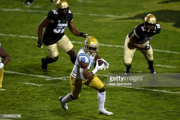 Bruins running back Demetric Felton Carrie the ball for a first quarter touchdown during a PAC 12 conference game between the Colorado Buffaloes and...