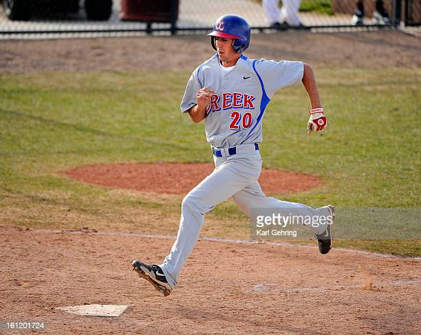 Bruins' senior Ben Bullard crossed the plate on a sacrifice fly ball in the fourth inning The Cherokee Trail High School baseball team hosted Cherry...