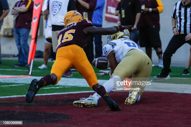 Bruins tight end Caleb Wilson catches a touchdown pass defended by Arizona State Sun Devils safety Cam Phillips during the college football game...