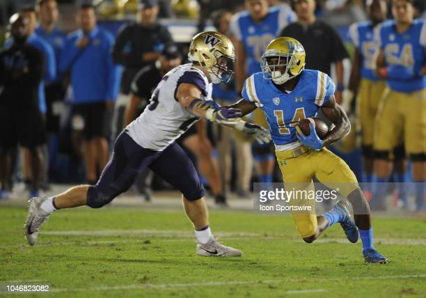 Bruins wide receiver Theo Howard catches a pass in the third quarter and tries to avoid Washington Huskies linebacker Ben BurrKirven in a game played...