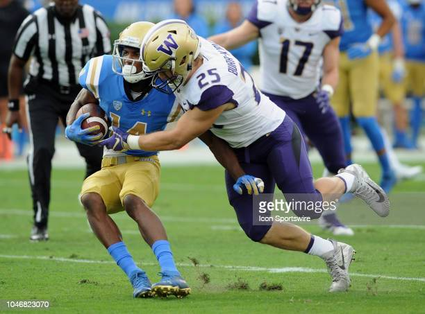 Bruins wide receiver Theo Howard is tackled after catching a pass in the first quarter by Washington Huskies linebacker Ben BurrKirven in a game...