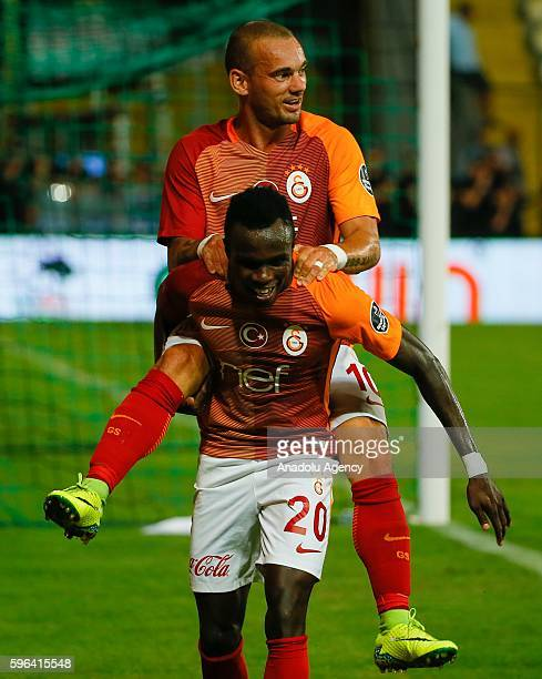 Bruma and Wesley Sneijder of Galatasaray celebrate their score during the Turkish Spor Toto Super Lig football match between Akhisar Belediyespor and...