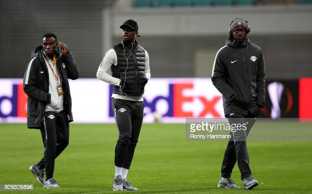 Bruma Jean Kevin Augustin and Dayot Upamecano of RB Leipzig arrive prior to the UEFA Europa League Round of 16 match between RB Leipzig and Zenit St...