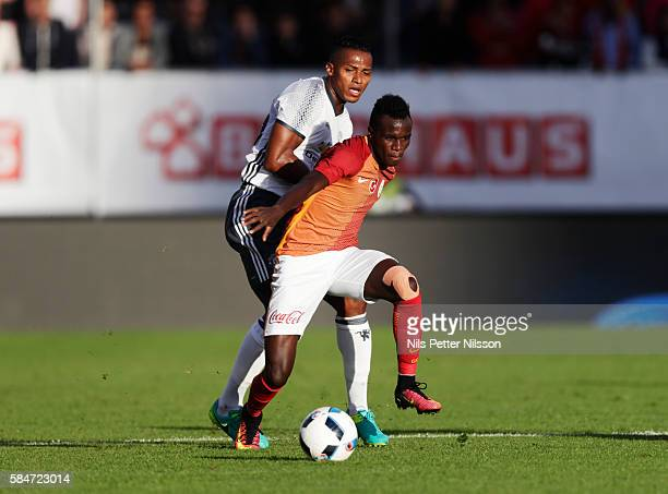 Bruma of Galatasaray and Antonio Valencia of Manchester United competes for the ball during the preseason Friendly between Manchester United and...