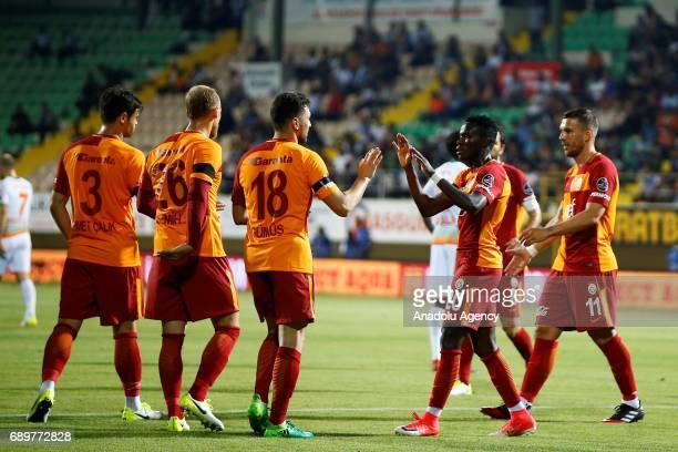 Bruma of Galatasaray celebrates with his teammates after scoring during the Turkish Spor Toto Super Lig match between Aytemiz Alanyaspor and...