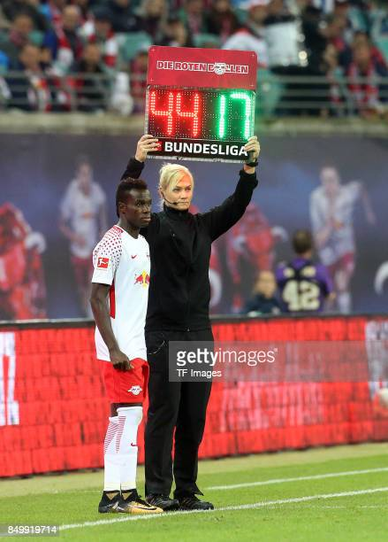 Bruma of Leipzig and Bibiana Steinhaus looks on during the Bundesliga match between RB Leipzig and Borussia Moenchengladbach at Red Bull Arena on...