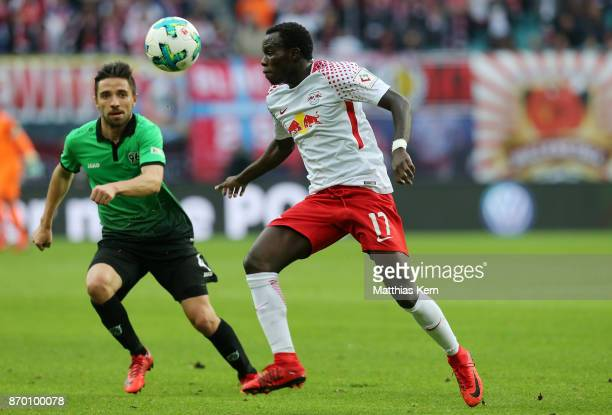 Bruma of Leipzig battles for the ball with Julian Korb of Hannover during the Bundesliga match between RB Leipzig and Hannover 96 at Red Bull Arena...