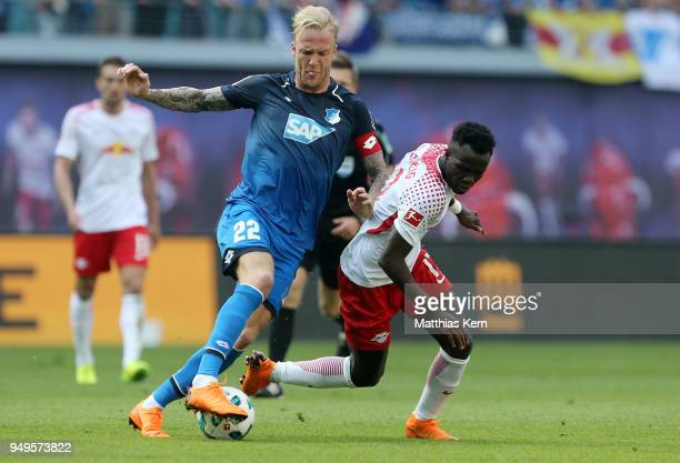 Bruma of Leipzig battles for the ball with Kevin Vogt of Hoffenheim during the Bundesliga match between RB Leipzig and TSG 1899 Hoffenheim at Red...