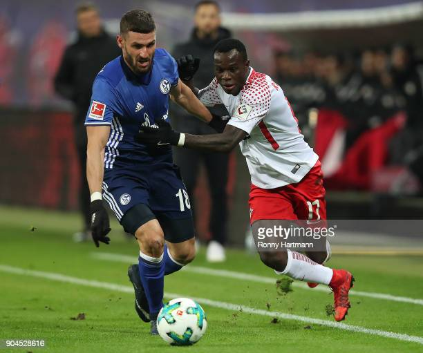 Bruma of Leipzig fights for the ball with Daniel Caligiuri of Schalke during the Bundesliga match between RB Leipzig and FC Schalke 04 at Red Bull...