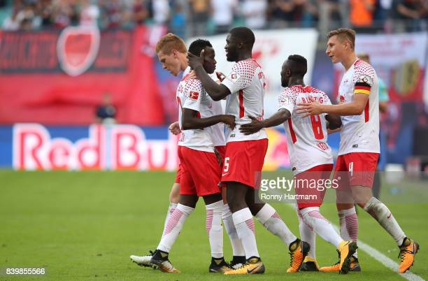 Bruma of Leipzig of Leipzig celebrates after scoring his team's first goal with team mates during the Bundesliga match between RB Leipzig and...