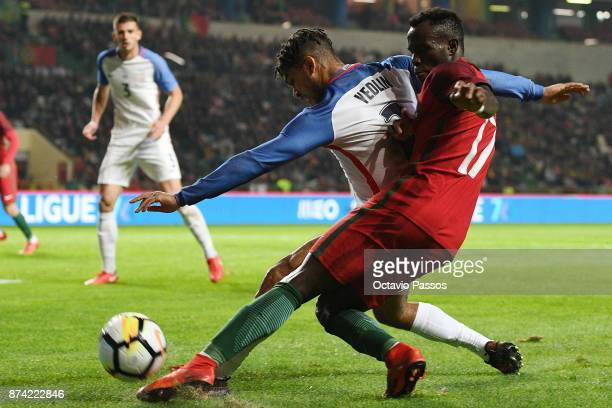 Bruma of Portugal competes for the ball with DeAndre Yedlin during the International Friendly match between Portugal and USA at Estadio Municipal...