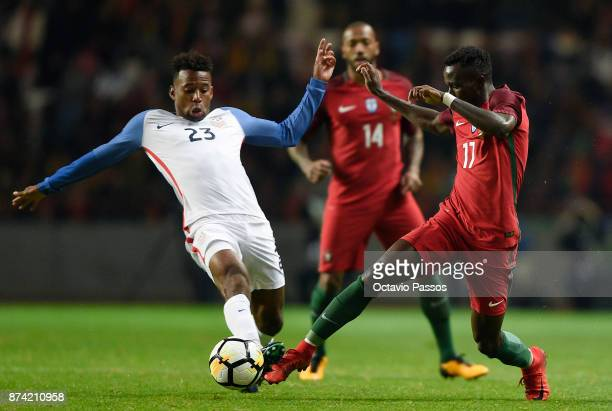 Bruma of Portugal competes for the ball with Kellyn Acosta during the International Friendly match between Portugal and USA at Estadio Municipal...