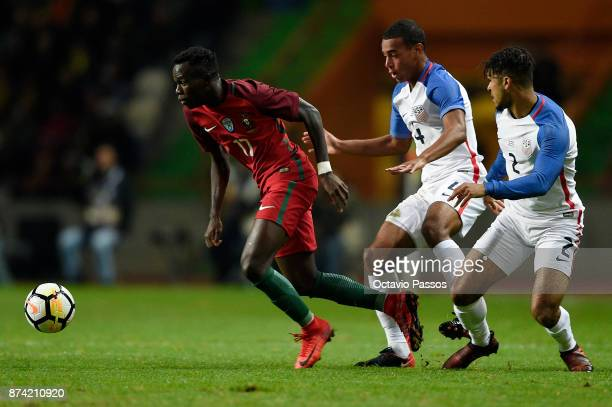 Bruma of Portugal competes for the ball with Tyler Adams during the International Friendly match between Portugal and USA at Estadio Municipal Leiria...